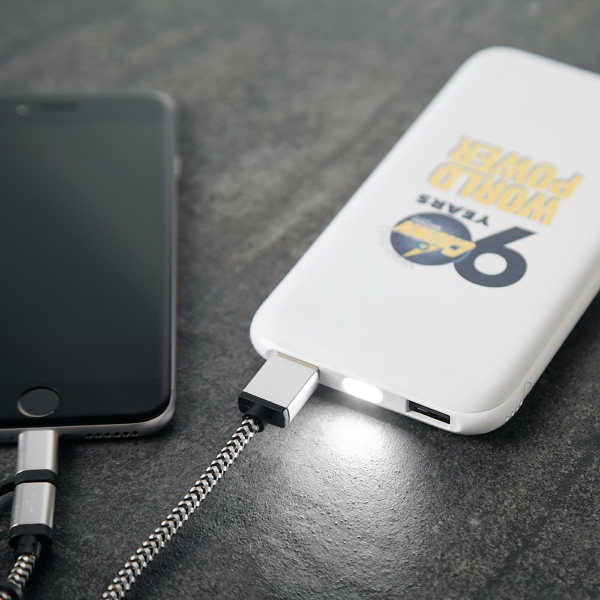 Soft rubberized dual USB power bank with bright LED light